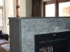 flamed-rustenburg-granite-fireplace-with-waterfall-cladding